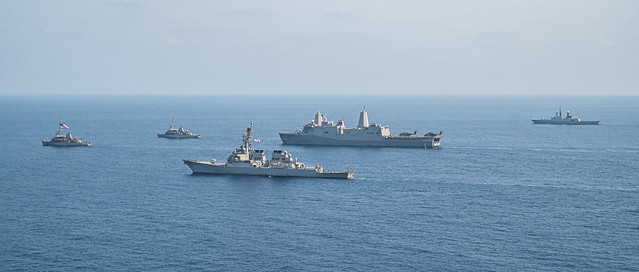 USS Sentry (MCM 3), left, USS Gladiator (MCM 11), USS O'Kane (DDG 77), USS Portland (LPD 27) and the Royal Saudi Naval Forces frigate Al Riyadh (812) transit the Red Sea during exercise Indigo Defender 21.