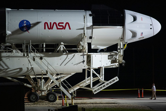 The SpaceX Falcon 9 rocket rolls out to the launch pad