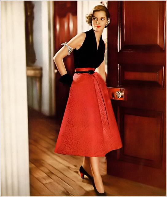 Model in evening halter of black velvet and short full skirt in red jacquard satin both from Simplicity Pattern 3159, photo by Genevieve Naylor, Harper's Bazaar, October 1950