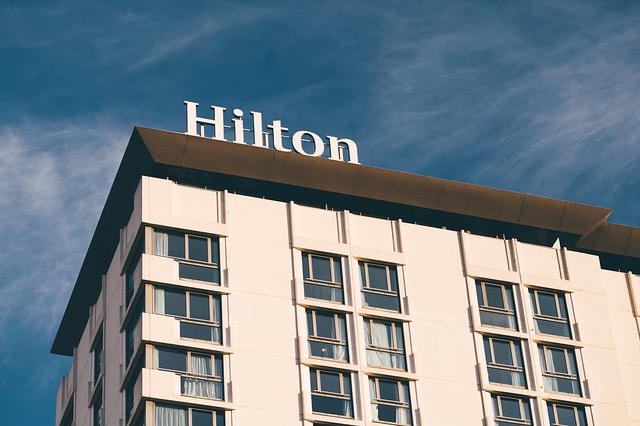 Hilton hotel sign on the roof of a building