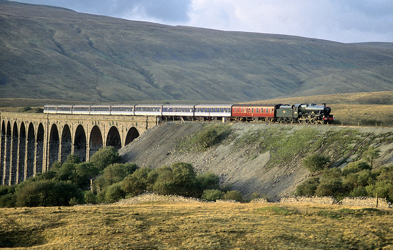 45596 'Bahamas' coasts off Ribblehead Viaduct with a Carlisle to Oxenhope train on the  4th October 1992. The less said about the coaching stock and total lack of exhaust, the better!