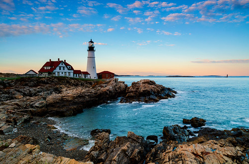 ocean new blue light sunset england lighthouse white rock clouds portland waves maine rocky atlantic shore coastline mygearandme