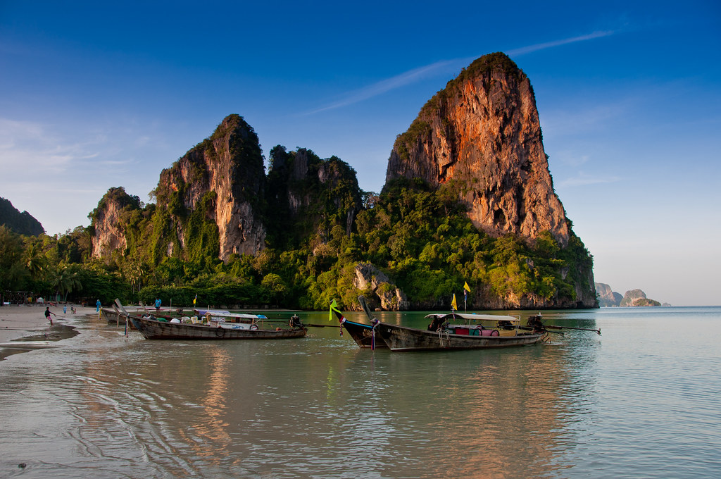 Railay Beach at Sunrise   A group of long-tailed boats sit a…   Flickr