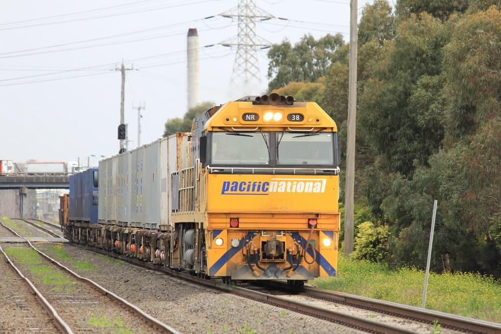 NR38 leads a short 11 wagon WX2 steel service near Spotswood by bukk05