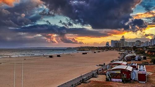 dark moody rain clouds sunset sky praiadarocha rockbeach beach water sea atlanticocean ocean reflections rocks portimao faro algarve portugal sonydschx20v aurorahdr2019 hdr aurorahdr luminar3 luminar