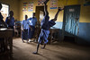 """Gbasshay, 10, plays with his classmates during their break time at Kroo Bay community school, Freetown, Sierra Leone. Hannah, a teacher, said: """"On the day the school reopened, maybe 50 children were here. There used to be 350. It took a long time for them to come. Now there are 250.""""  Photo credits: EU/ECHO/Jonathan Hyams"""