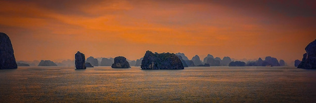 Halong Bay islands with sunset tint