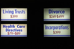 Sign advertising legal services: LIVING TRUSTS, DIVORCE, HEALTH CARE DIRECTCTIVES, INCORPORATIONS, strip mall, Anaheim, California.jpg   by gruntzooki