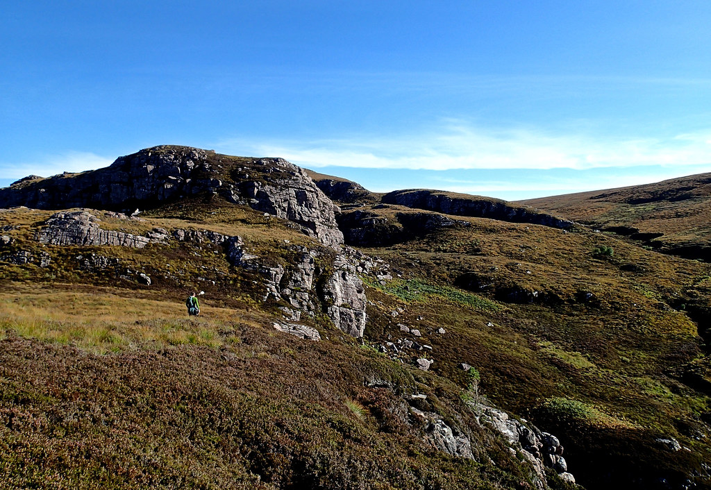Tue, 2015-10-13 13:37 - Steve walking off from the top of Dancing Buttress, Ardmair Crags.  The steep crab beyond is Front Face, where Burning Desire goes at the mid-height roof directly. A fantastic day in autumn and we had the whole crag by ourselves.