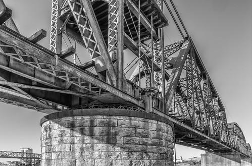 trestle bridge blackandwhite bw wheel rock rust patterns cement column gears mechanism shreveport bossiercity leadingline redriverrailroadbridge sonya7rii