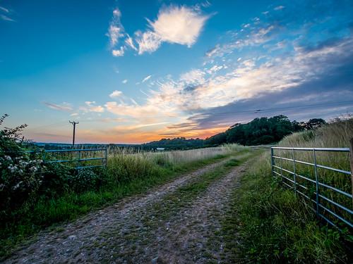 blue trees orange green clouds rural lumix gate farm panasonic g5 hdr
