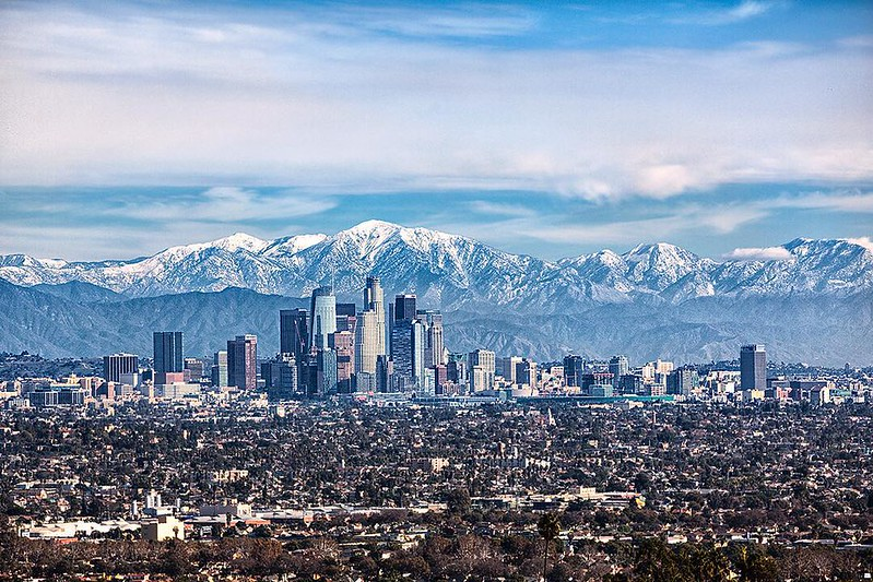 View of downtown Los Angeles and snow covered San Gabriel Mountains from Kenneth Hahn State Recreation Area. Photographed Christmas Day 2016 by Ming Lo.