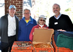 L-R: Past Pres. of NRRC Jay Williams, Rich Lewis, Linda Brooks and Paul Stone are serving the pizzas that were donated by Rotarian Mike Aoun.