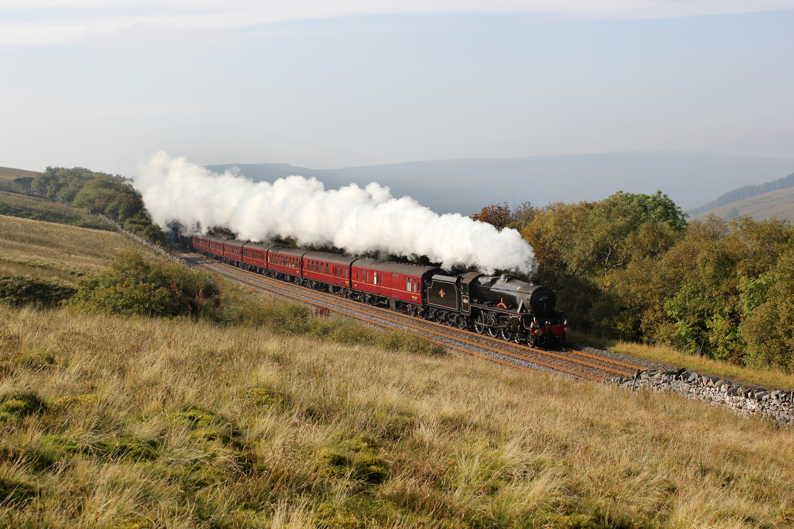 Black Five No.45231 heads a West Coast Railways excursion originating from Cleethorpes along the upper side of Garsdale, before plunging into the fog filled Eden Valley.