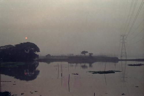 winter sunset mist film water misty fog analog landscape evening swamp nikonfm10 fujifilm dhaka bangladesh 3570mmf3548 fujicolorc200 dhakadivision epsonv330 sheikhshahriarahmed