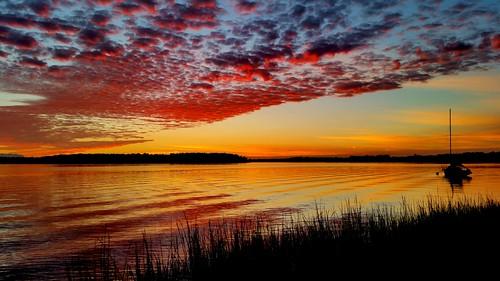 sunset water clouds boats bay waves shoreline shore sailboats cloudporn skyporn galaxys5