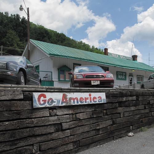 2010 20100723 americanflag cityofwar goamerica goamericasign img7265 july july2010 mainstreet mcdowellcounty route16 stateroute16 usflag war warcityhall warstation warwestvirginia warlandscape westvirginia westvirginiaroute16 westvirginialandscape building cars cityhall cityhallsign cumulus cumulusclouds downtown downtownwar flag foldingchair greenandwhite greenandwhitebuilding greenroof landscape lightpole oldsign parkedcars parking parkinglot paved pavement powerlines railroadtieretainingwall railroadties redwhiteandblue retainingwall roof sign signs southernwestvirginia southernwestvirginialandscape utilitypole view wall woodretainingwall woodenretainingwall wornsign unitedstates