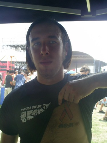 Warped Tour: Pink Ribbon tattoo in honor of his mother who… | Flickr