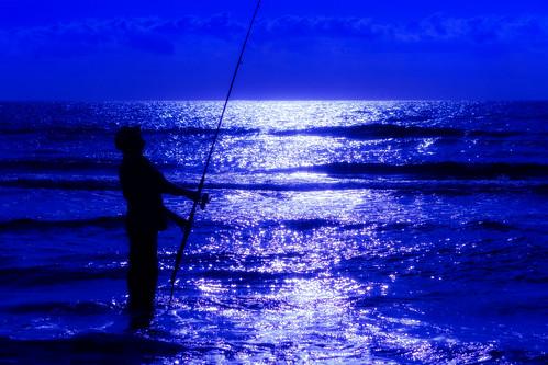 blue sea people man reflection beach water silhouette sunrise outside fishing outdoor highcontrast serene