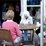 Women laughing at a coffee morning | A group of women enjoy a coffee morning at the Book Festival © Helen Jones