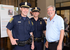 State Representative Dr. Bill Petit posed for a photo with two Hartford police officers during an event.