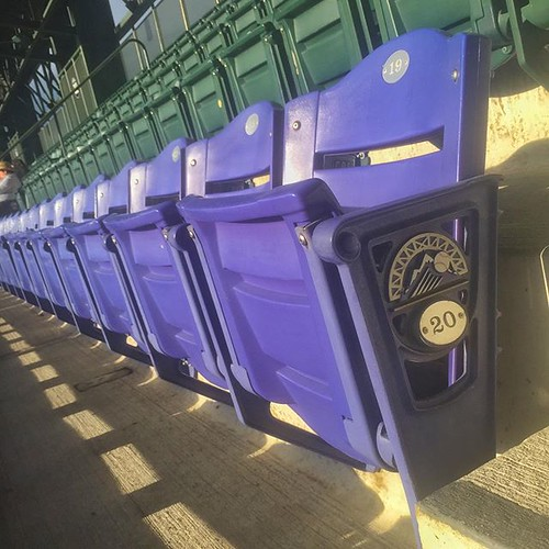 This purple row of seats at @Rockies Coors Field in #Denver is exactly one Mile High.   by Flying Photog