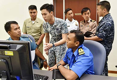 Participants from the seven nations taking part in SEACAT 2015 work together at the Changi Command and Control Centre, Oct. 5. (Photo courtesy of the Singapore Ministry of Defence)