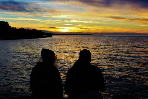 sunset sundown lateafternoon goldenlight water lake bay harbor silhouettes togetherness friendship sharing lakemichigan petoskey michigan jannagalski jannagal reflection reflectedlight sunglasses woman youngwoman goldenhour ripples