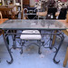 Ornate metal framed and glass top dining table