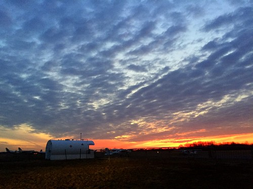 sunset clouds new jersey nj solberg airport gas tank planes winter