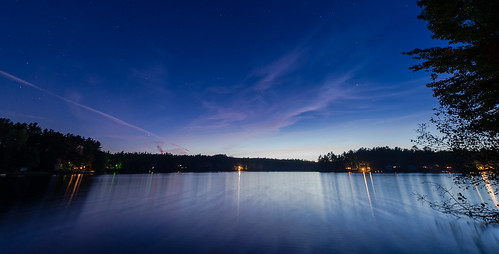 blue sky reflection water clouds stars pond glow dusk maine loon