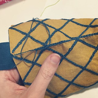 Finishing up the edges of the pouch with chain stitch. | by beautysmuse