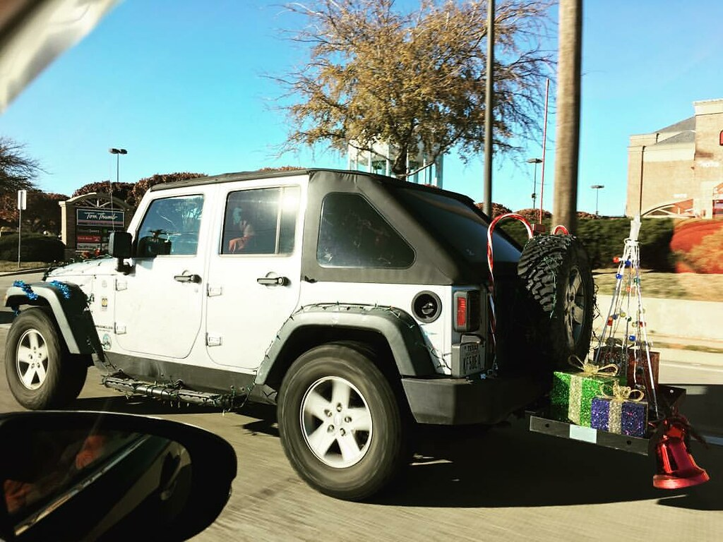Christmas Jeep.Christmas Jeep Lights Garland Candy Canes Presents Be
