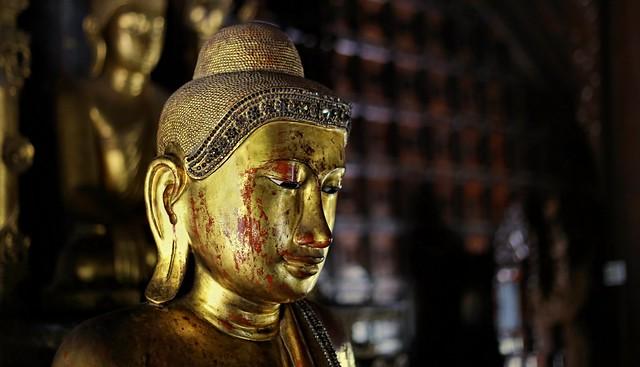 Sumptuous Buddha image in the main rooom of Shwe In Bin Kyaung Monastery