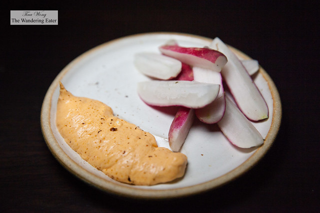 Amuse of breakfast radishes and pimento cheese