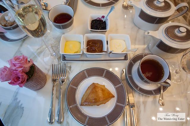 Plain scone with our spreads - vanilla cream, orange marmalade, Devonshire cream, and blueberry jam