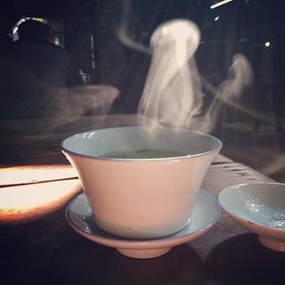 A cup of green tea. #city #china #streetphotography #tea #teahouse #drinks @nytimestravel #chongqing | by PhotoSino