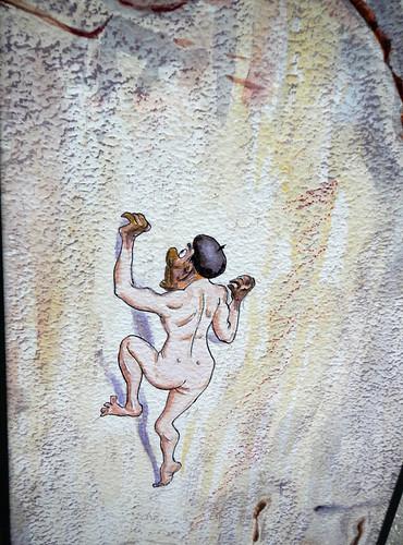 A Sign Showing a Cartoon of Climbing the Picos de Europa Naked