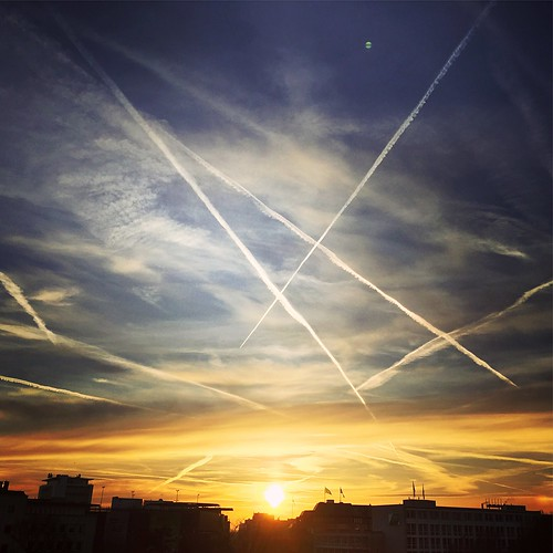 vaportrail sky silhouette lowangleview sunset nature city nopeople contrail outdoors architecture scenics beautyinnature day dramaticsky beautifulpollution