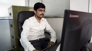 Employee Works on Nepal Trade Information Portal   by World Bank Photo Collection