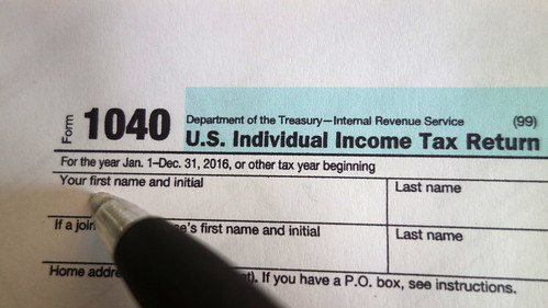IRS 1040 Form Being Filled Out - Doing Taxes | by Senior Guidance