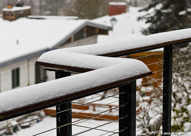 Snow on the cable railing