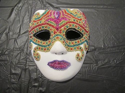 Mardi Gras mask decorated with beads. Photo by Briana Prevost