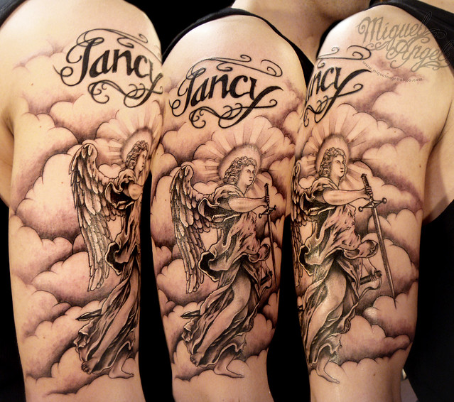 Angel and clouds and touch up name tattoo