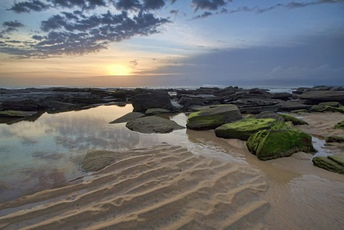 ocean seascape beach sunrise reflections dawn sand rocks