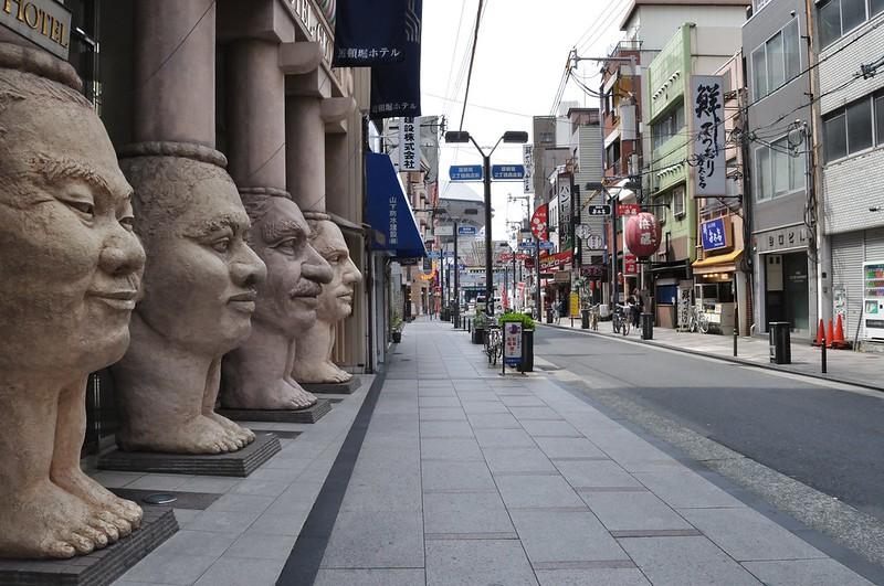 Strange statues outside the Dotonburi Hotel, Namba