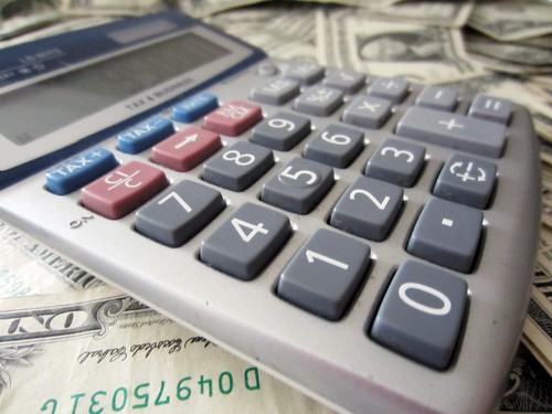 Calculator and Money | by 401(K) 2013