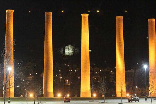 the smoke stacks at the Waterfront at night