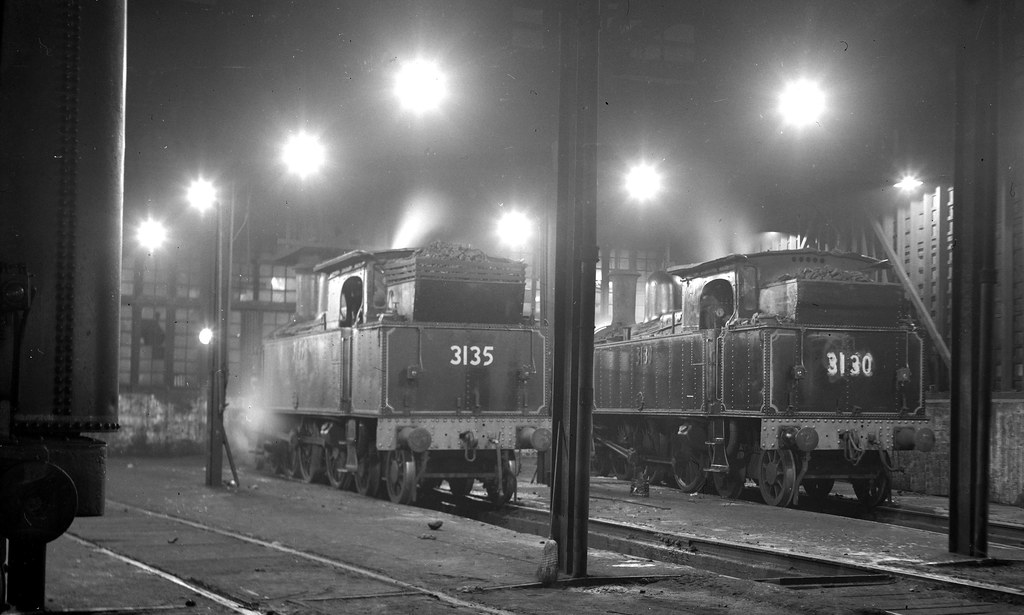 12319 (523) 16-05-1968 New South Wales Government Railways 4-6-4 steam tank locomotives 3135 and 3130 over the pits in one of the three roundhouses at the locomotive depot at Enfield, Sydney, N,S.W., Australia by John Ward