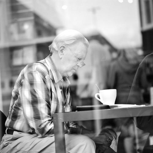 """Image titled """"Man through window, Akureyri, Iceland."""""""